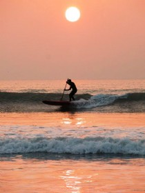 SUP Sliding a Croyde pink sunset
